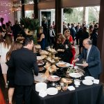 wedding guests at food buffet table